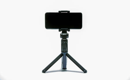 smart phone and tripod isolated on white background Standard-Bild