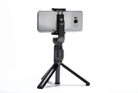 smart phone and tripod isolated on white background Stockfoto