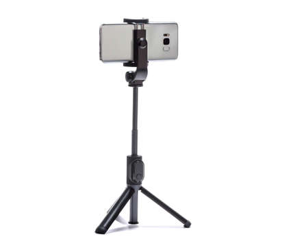 smart phone and tripod isolated on white background Stock Photo