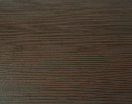 Decorative surface imitating the texture of dark wood of the oak wenge. Close-up