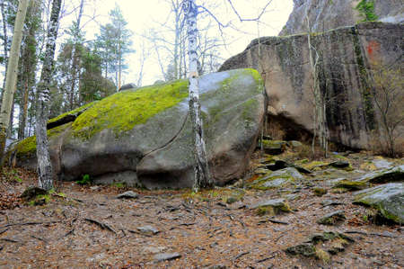 The nature reserve Stolby , stones processed by water and wind over the millennia to freakish forms. The picture was taken on a cloudy summer day. Krasnoyarsk, Siberia, Russia.