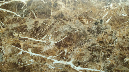 Fragment of a slab of natural stone brown marble with white veins recalling the texture of a natural pattern Stock Photo
