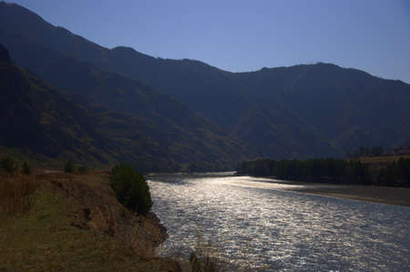 The suns rays are reflected in the course of the fast Katun River. Altai, Siberia, Russia. 写真素材