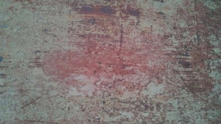 Old metal wall damaged by rust. 免版税图像