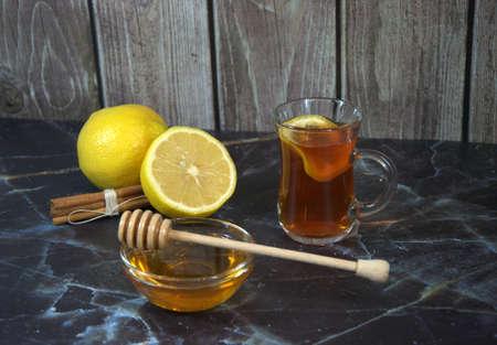 Cold medicine, tea with lemons, honey and cinnamon sticks.