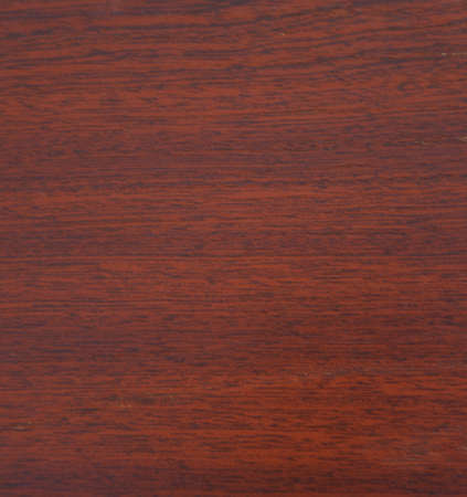 Mahogany, natural drawing of wood texture on a slice closeup. Background, texture.