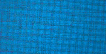 Blue flaxen fabric with small weaving closeup. Background, texture.