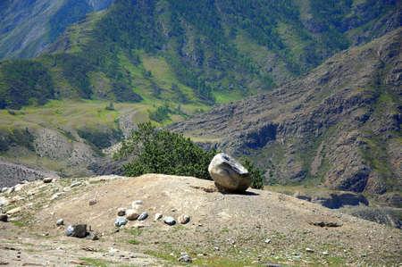 Bizarre cobblestones on top of a hill overlooking a fertile valley. Altai, Siberia, Russia.