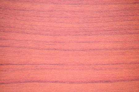 Natural red cherry, wood texture on a saw close-up. Background.