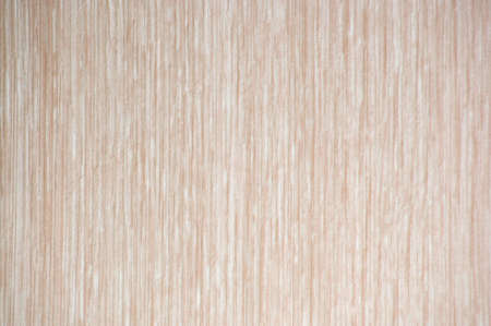 Clarified walnut, saturated pattern with vertical stripes on the cut, close-up. Background, texture.
