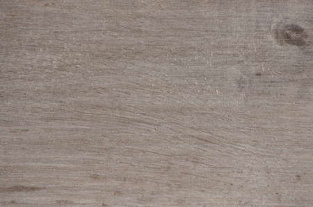 Close-up of the lightened surface of natural dark walnut wood on the saw cut. Background, texture. 写真素材