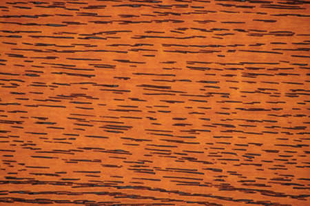Dark beech, polished natural dark wood surface with small black stripes close-up. Background, pattern, texture. Standard-Bild