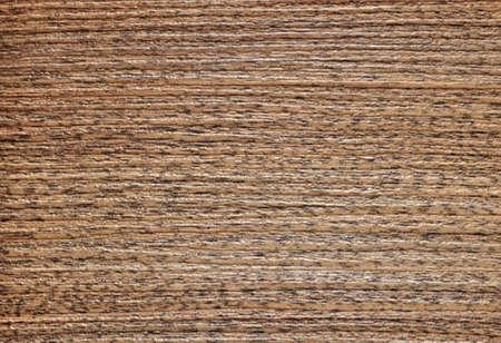 Close-up cut of dark ash, polished natural wood surface. Background, pattern, texture. Standard-Bild