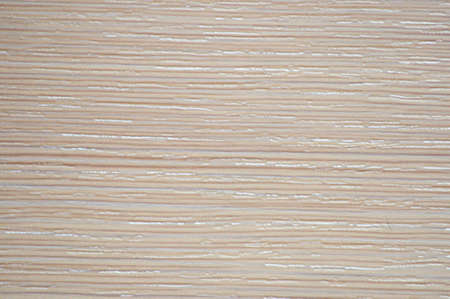 Bleached beech, polished natural light wood surface close-up. Background, pattern, texture.