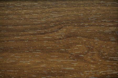 Dark walnut wavy pattern of natural wood close-up. Background pattern texture.