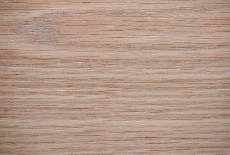 Lightened cherry, polished surface of natural light wood with a wavy-striped pattern. Background, pattern, texture.