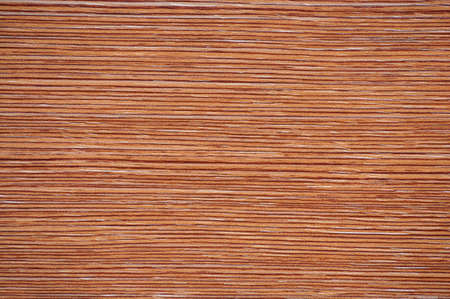 Dark red beech, polished flat surface of natural wood, close-up on a cut. Background, pattern, texture. Standard-Bild