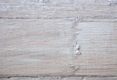 The surface of the old light wood with traces of rough sanding and the joints between the boards, close-up. Background, pattern, texture. Standard-Bild
