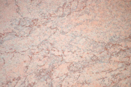 Pale pink agate, a polished natural stone surface with bright red veins. Background, pattern, texture.