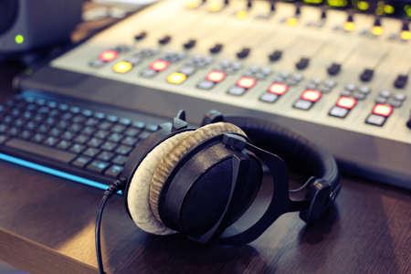 Stereo headphones on the Desk in the Studio