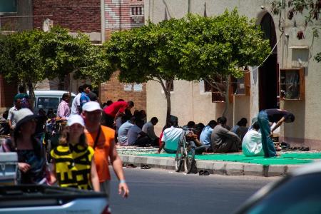 HURGHADA, EGYPT - July 29: Muslims listen to a prayer, July 29 2011