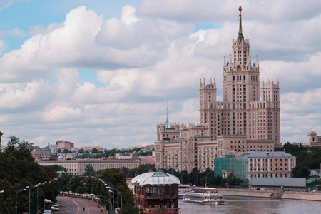 Stalin skyscraper on embankment of river Moscow