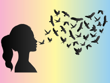 Silhouette of a woman and a flock of birds in heart shape. Stock Photo