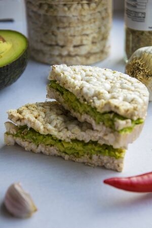 Rice cake with cream cheese and avocado.Vegan Food
