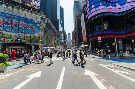 new york times: NEW YORK CITY - JULY 12: Undefined people pass through Times Square on July 12, 2012 in New York. Times Square is a major commercial intersection in Manhattan.
