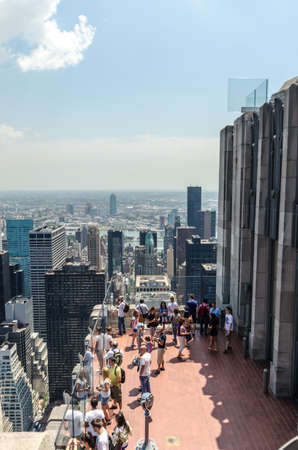 NEW YORK CITY - JULY 12: People look at Manhattan from Rockefeller Center Observation Deck on July 12, 2012 in New York. Manhattan is a major commercial, economic, and cultural center of the United States.