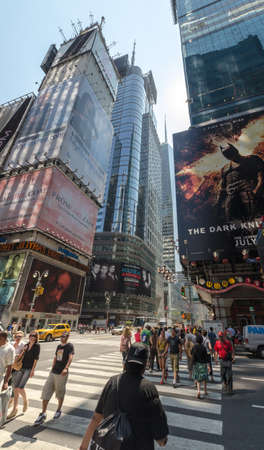 new york times: NEW YORK CITY - JULY 12: Undefined people pass through Times Square on July 12, 2012 in New York. Times Square is a major commercial intersection in Manhattan at the junction of Broadway and Seventh Avenue.