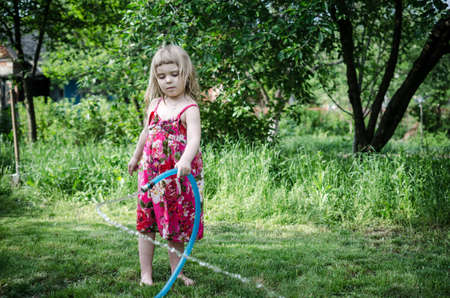 water hose: Girl play with water hose