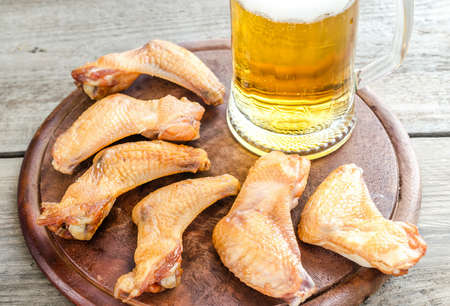 Chicken wings with beer photo