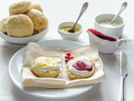 Scones with curd and jam photo