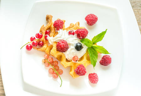 waffles with cream and berries photo