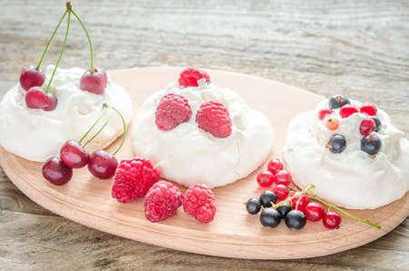 meringue with whipped cream photo