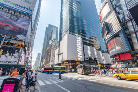 new york times: NEW YORK CITY - JULY 22: Undefined people pass through Times Square on July 22, 2014 in New York. Times Square is a major commercial intersection in Manhattan, at the junction of Broadway and 7th Ave. Editorial