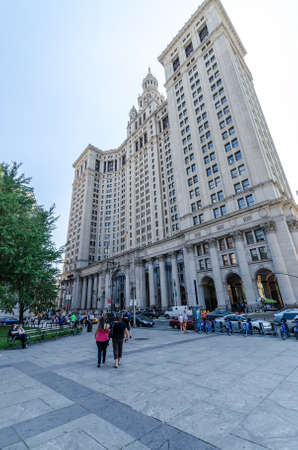 boroughs: NEW YORK - JUL 17: The Manhattan Municipal Building in July 17, 2014 on NYC. It is a 40-story building built to accommodate increased governmental space demands after the consolidation of 5 boroughs. Editorial