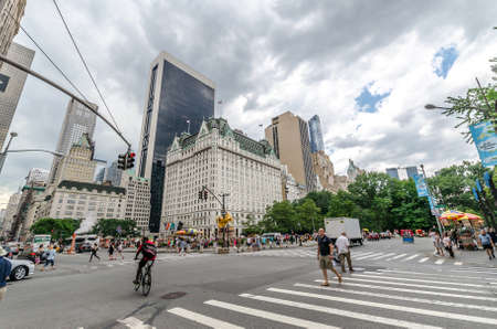 NEW YORK CITY - JUL 17: Grand Army Plaza in New York on July 17, 2014. Grand Army Plaza lies at the intersection of Central Park South and Fifth Avenue in front of the Plaza Hotel in Manhattan.