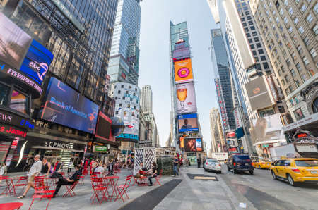 new york times: NEW YORK CITY - JULY 22: People visit Times Square on July 22, 2014 in New York. Times Square is a major commercial intersection in Manhattan, at the junction of Broadway and 7th Ave.
