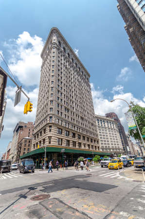 broadway tower: NEW YORK CITY - JUL 22: Flatiron Building in NYC as seen on July 22, 2014 in New York. This iconic triangular building located in Manhattans Fifth Ave was completed in 1902.