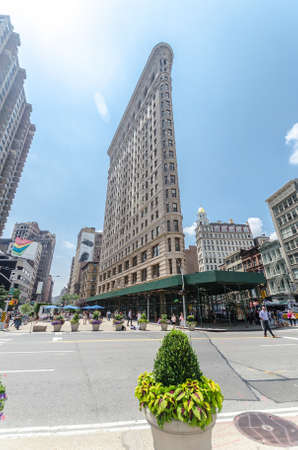 manhattans: NEW YORK CITY - JUL 22: Flatiron Building in NYC as seen on July 22, 2014 in New York. This iconic triangular building located in Manhattans Fifth Ave was completed in 1902.