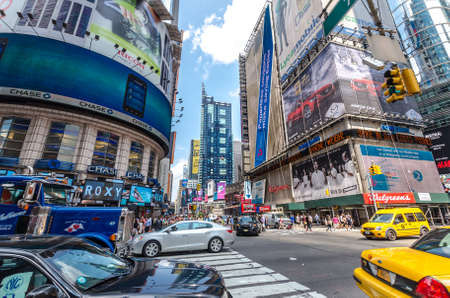 42nd: NEW YORK - JUL 22: 42nd Street near Times Square with traffic and commercials on July 22, 2014 in New York. 42nd Street is a major crosstown street known for its theaters and landmark architectures. Editorial