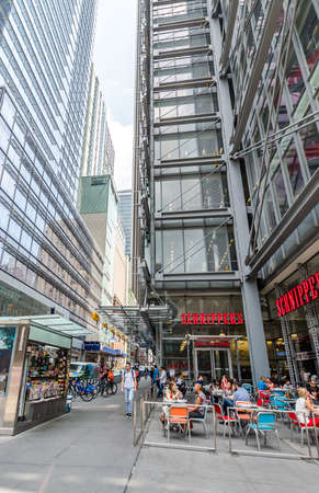 eighth: NEW YORK CITY - JUL 22: Cafe on 8th Avenue on July 22, 2014 in New York City. Eighth Avenue is a north-south avenue of Manhattan, carrying northbound traffic. Editorial