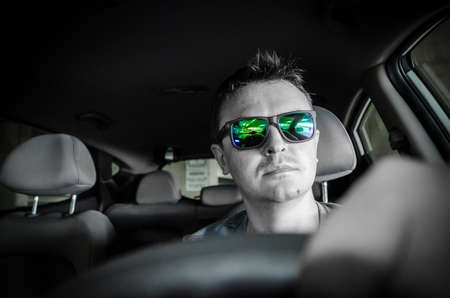 mirrored: man driving a car Stock Photo