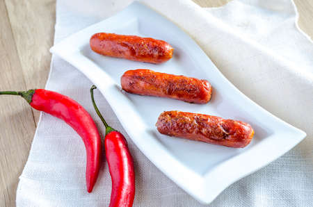 sausages on white plate photo