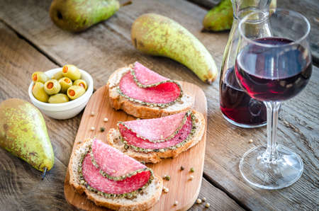Italian salami with pears and wine photo