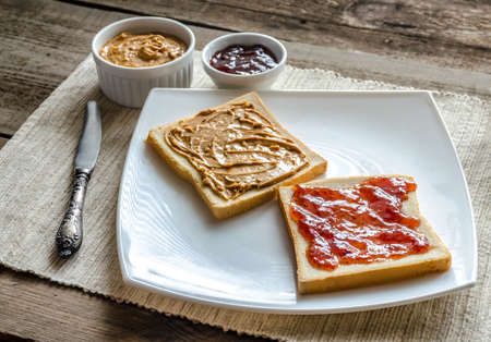 peanut butter and jelly: sandwich with peanut butter and jelly