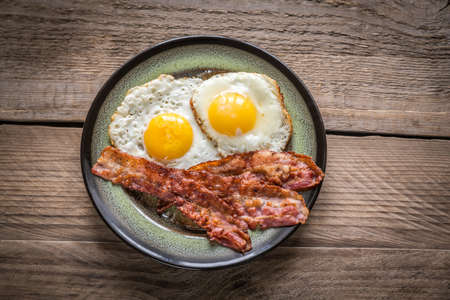 Bacon with eggs Stock Photo