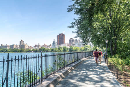 eldorado: NEW YORK CITY - JULY 10: People walk near Jacqueline Kennedy Onassis Reservoir JKO on July 10, 2015 in NYC. JKO is a decommissioned reservoir in Central Park in the borough of Manhattan.